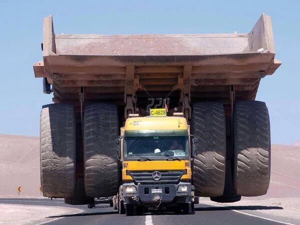 How do you transport a giant, 240-ton mining truck? A Mercedes. - Incredible Photo - Road & Track