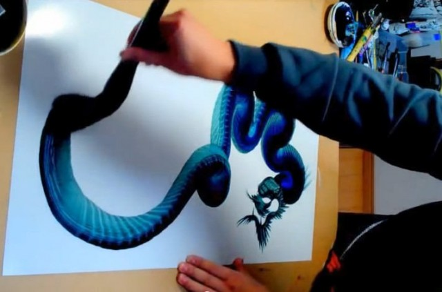 Watching this guy draw a dragon makes my brain go into trance mode